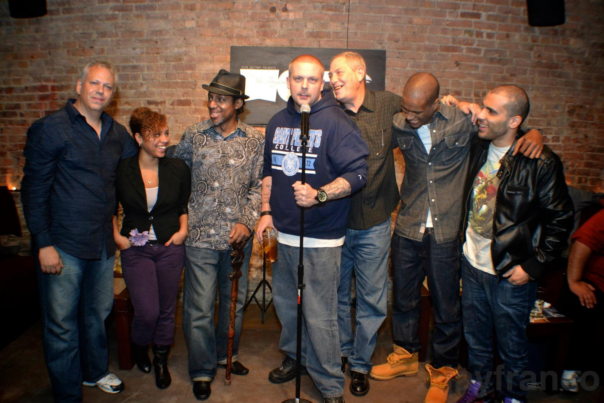 mc/host/HBO Def Poetry Star, Gemineye posing with TIW family